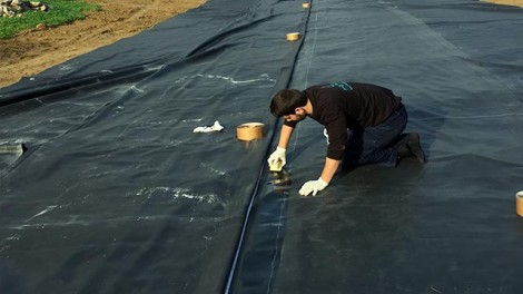 Preparing Firestone EPDM lining - Preparing Firestone EPDM lining