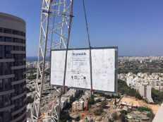 Pool window installation with crane